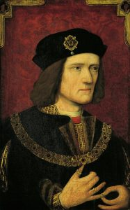 Portrait of Richard III, King of England wearing a gold chain, jeweled brooch and rings.