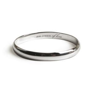"Bangle with ""An Ocean of Love"" engraved on the inside"