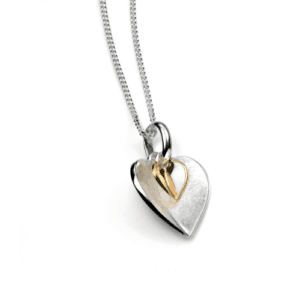 Pendant with a silver and yellow gold heart, one sitting inside the other