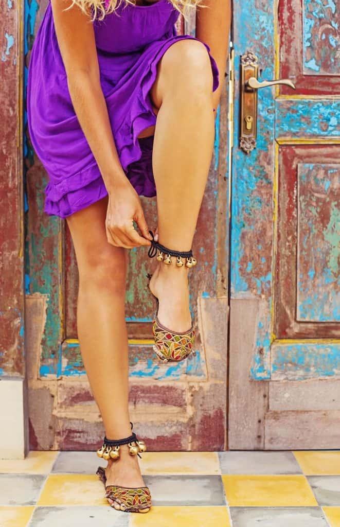 Lady in purple dress wearing anklets