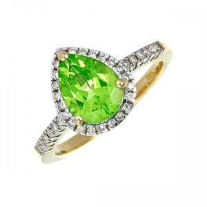 18ct gold teardrop peridot the August birthstone and diamond cocktail ring