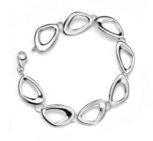 Silver bracelet with cut out pebble shapes