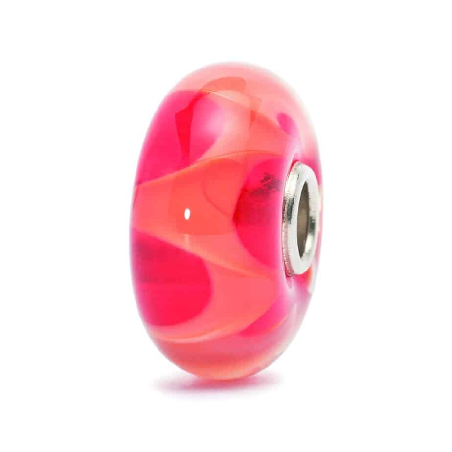 Trollbeads glass charm bead for modern charm bracelet in red with a Coral Wave running through the glass