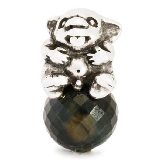 Trollbeads bead for modern charm brarcelet with a silver Troll creature sitting on top of a bead of blue tigers eye
