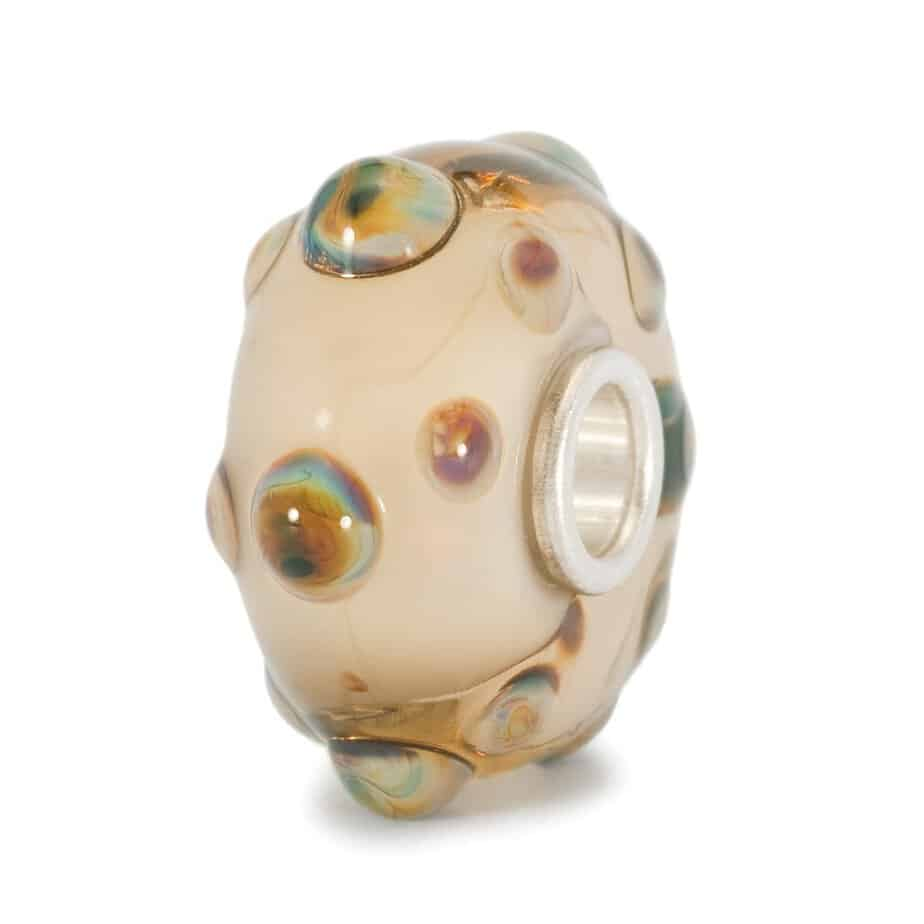 Trollbeads glass charm bead for modern charm bracelet in beige colours with pale brown raised dots of glass on the surface