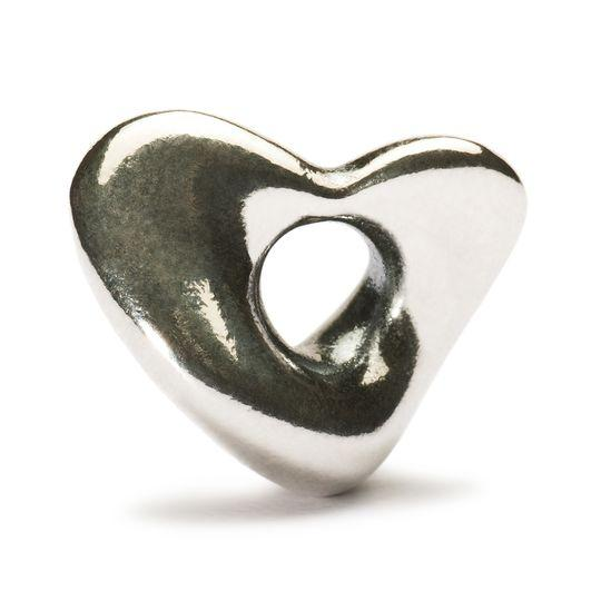 Trollbeads silver charm in the shape of a curved heart for a modern charm bracelet