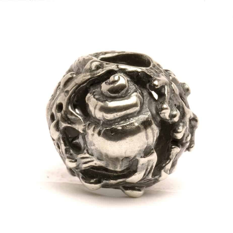 Trollbeads silver bead covered in seashells, seaweed and shell shapes and called Treasures