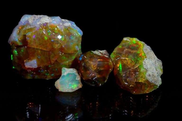 A few pieces of Precious Opal gemstone on a black background